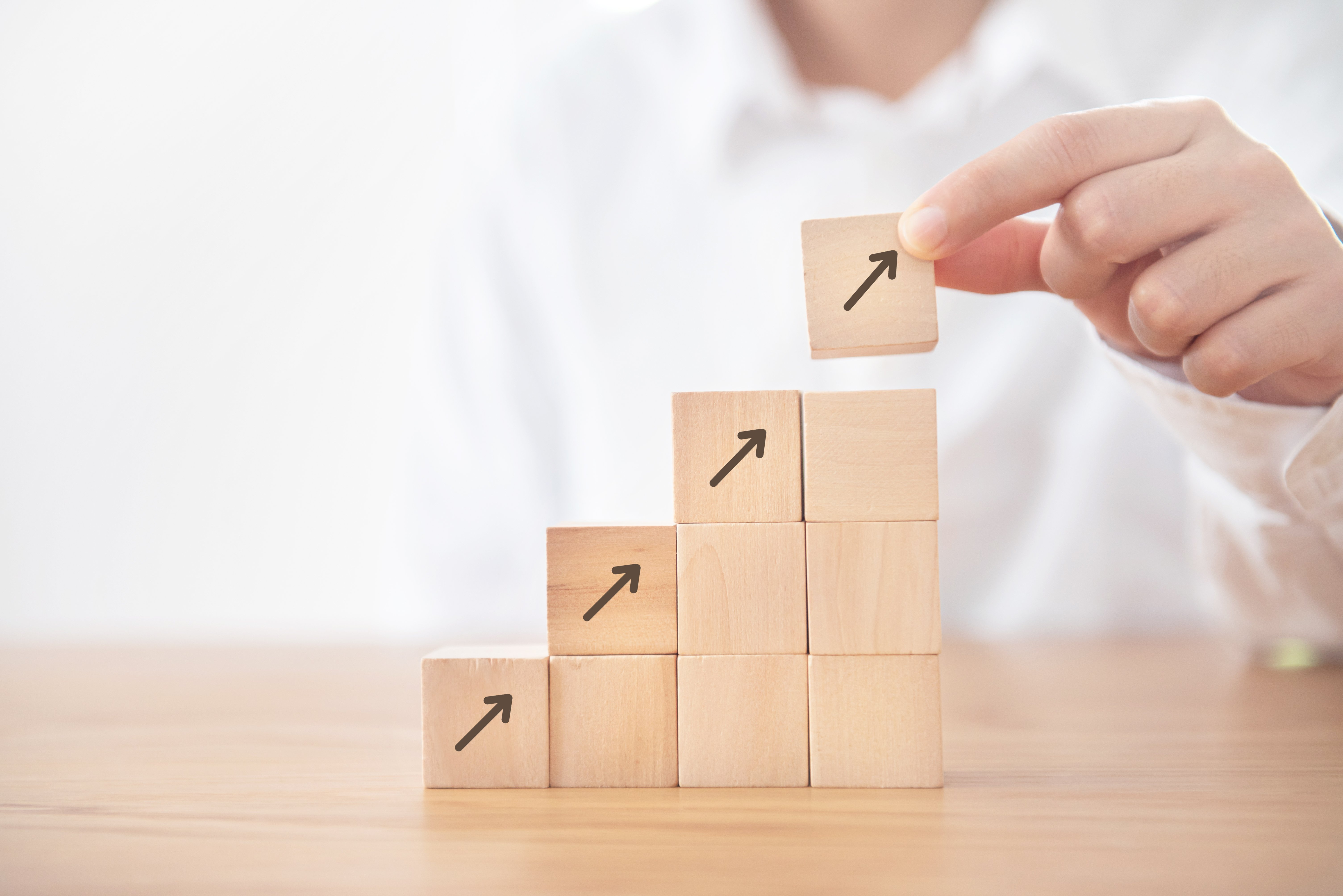 business-concept-growth-success-process-businesswoman-hand-arranging-wood-cube-stacking-as-step-stair-with-arrow-up-symbol