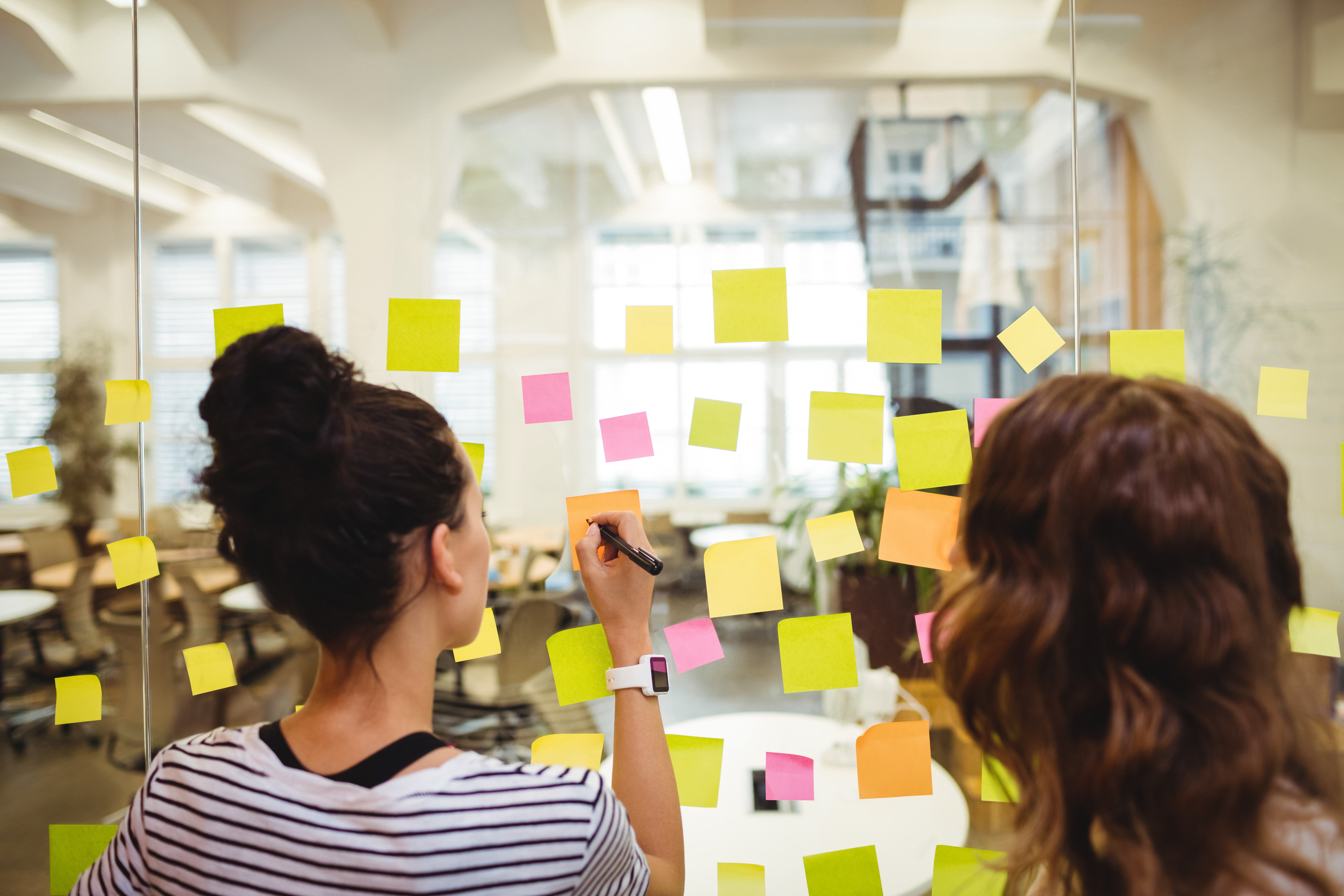 business-executives-writing-sticky-notes