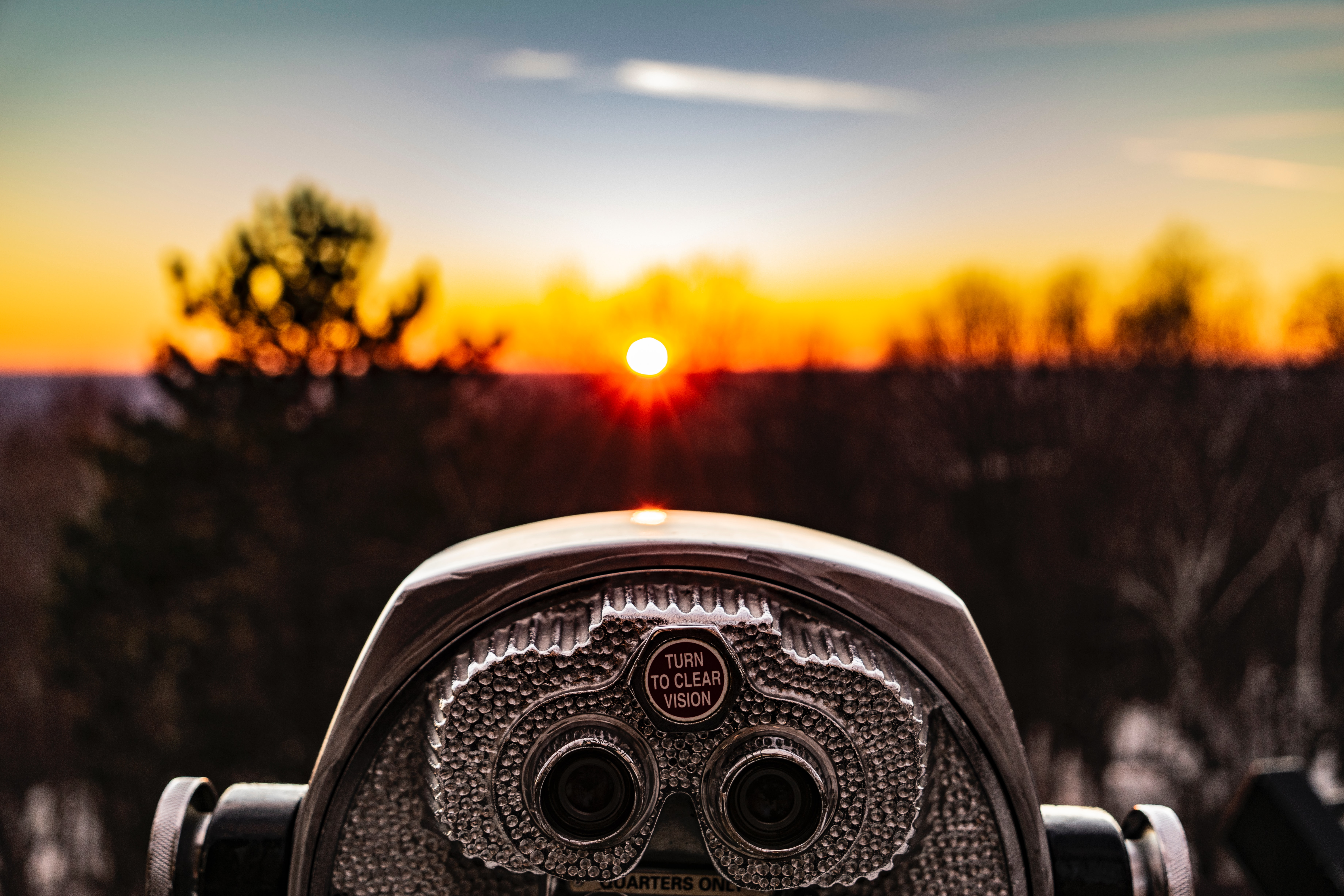 Binoculars looking at a sunset